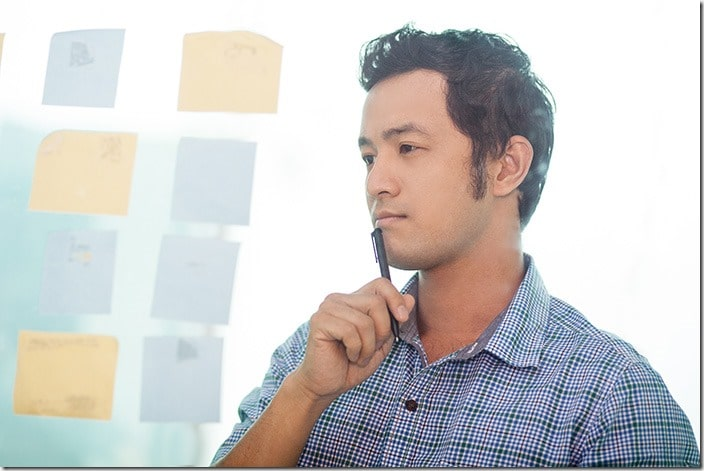 Thoughtful Young Asian Business Man Planning Work